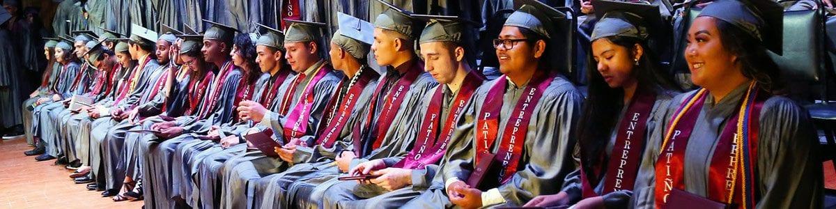 A row of Fresno Unified graduates at a graduation ceremony